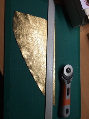 Cutting the gilded leather/ Photo by Historical Textiles